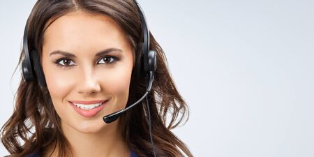 Photo pour Portrait of happy smiling young support phone operator, sales phone agent or businesswomen in headset, with blank copyspace area for slogan or text - image libre de droit