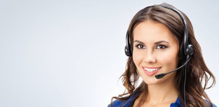 Photo pour Portrait of happy smiling young support phone operator, sales phone agent or businesswomen in headset, with blank copy space area for slogan or text - image libre de droit