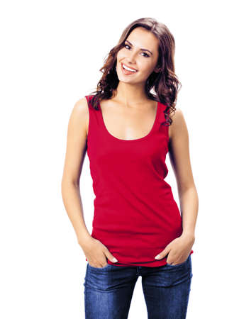 Photo pour Portrait photo - smiling woman in red color casual smart clothing, blue jeans, isolated over white background. Happy girl in t-shirt at studio. Brunette Model posing at studio picture. - image libre de droit