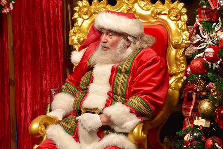 Orlando, Florida; November 24, 2018. Cute Santa Claus waiting for children in International Drive area.