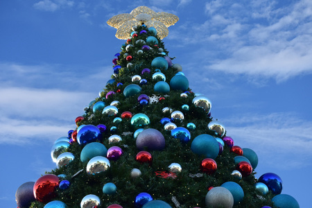 Orlando, Florida. November 17, 2018. Decorated Christmas tree lightblue cloudy background in International Drive area.