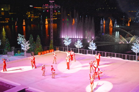 Orlando, Florida. November 19, 2018. End of Christmas Show on ice on colorful background with holidays trees over the lake in International Drive area.
