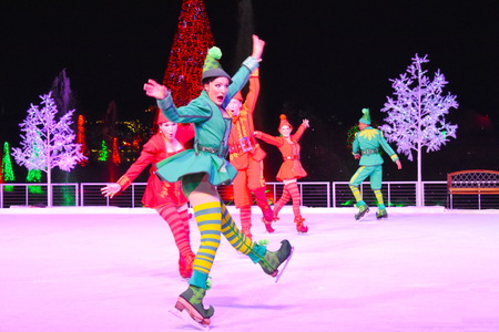 Orlando, Florida. November 17, 2018. Funny Woman Elf skating on ice at Chritsmas Show in International Drive area.