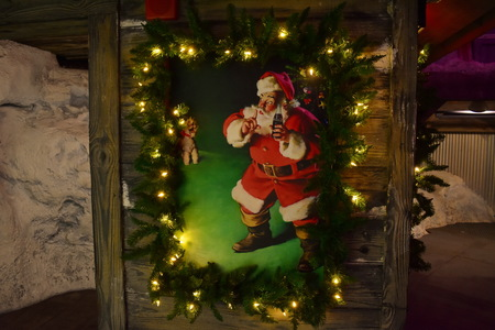 Orlando, Florida; November 24, 2018. Vintage painting of Santa Claus on wooden background in International Drive area.