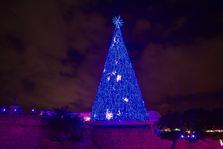 Orlando, Florida. November 20, 2018. Illuminated Christmas Tree on cloudy sky background in International Drive area