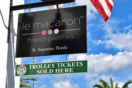 St. Augustine, Florida. January 26, 2019. Le Macaron Pastries an Trolley Tickets signs at Old Town in Floridas Historic Coast.
