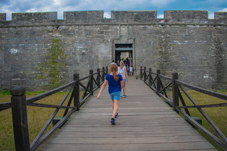 St. Augustine, Florida. March 31, 2019. Girl walking in main entrance of Fort San Marcos Castle in Florida's Historic Coast.