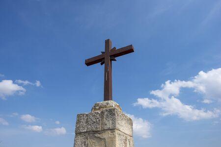 Photo pour A Christian cross under a blue sky with clouds, Spain - image libre de droit