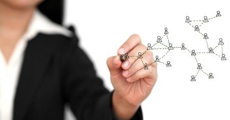 Photo pour Asian business woman drawing Social Network Concept (selective focus) - image libre de droit