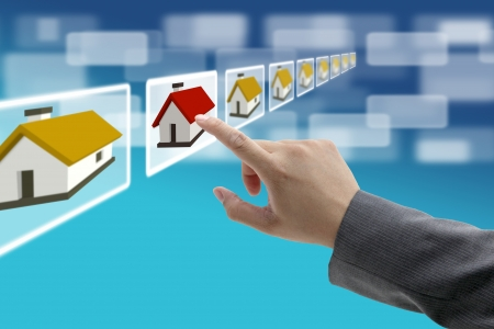 man hand Finding new property in real estate market with electronic commerce concept