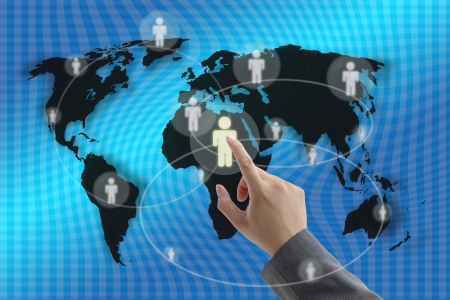 Businessman hand touching virtual screen interface with world recruitment background