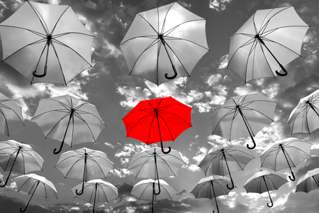Foto de umbrella standing out from the crowd unique concept - Imagen libre de derechos