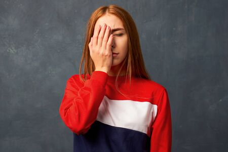Photo pour Young woman puts hand to face in shame. facepalm - image libre de droit