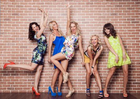 Photo pour Group of cheerful beautiful woman on brick background. Bachelorette. - image libre de droit