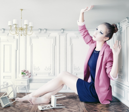 beautiful young girl in little room. creative concept