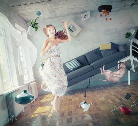 Foto de young beautiful lady fly in zero gravity room. creative concept - Imagen libre de derechos