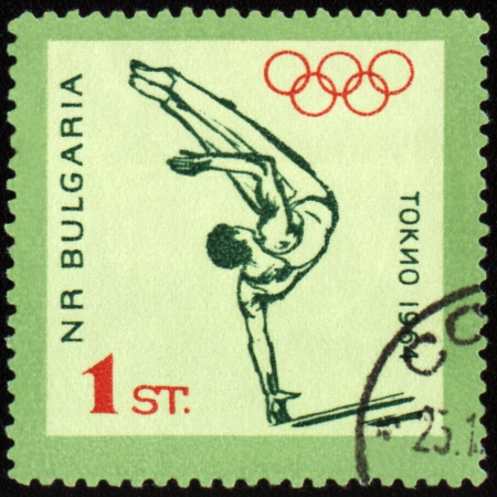 BULGARIA - CIRCA 1964: A post stamp printed in Bulgaria shows gymnastics, devoted to Olympic games in Tokio, series, circa 1964