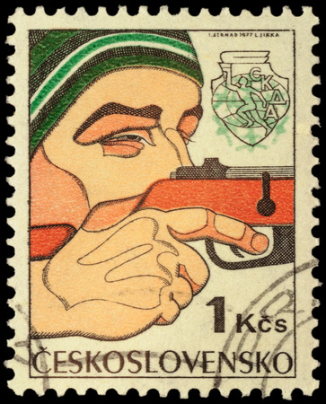 CZECHOSLOVAKIA - CIRCA 1977: stamp printed in Czechoslovakia shows Man sighting rifle, biathlon, devoted to the 6th Winter Spartakiad of Warsaw Pact Armies, 