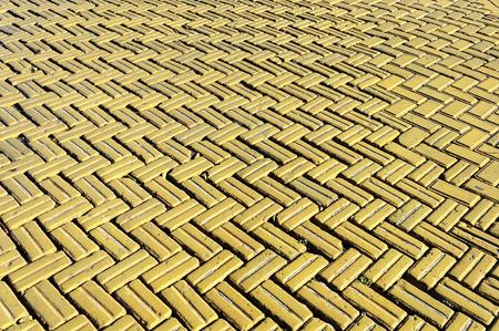 Yellow tiles, the surface of the carriageway on Deribasovskaya Street in Odessa