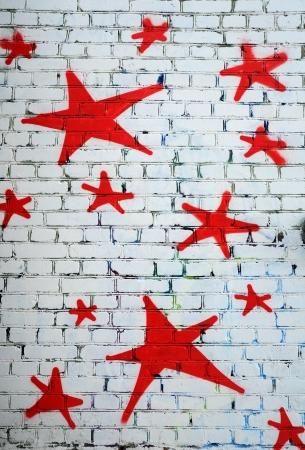 Red stars on the white brick wall