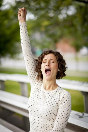 Woman Cheering At The Park