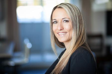 Photo pour Portrait Of A Businesswoman Smiling At The Camera - image libre de droit