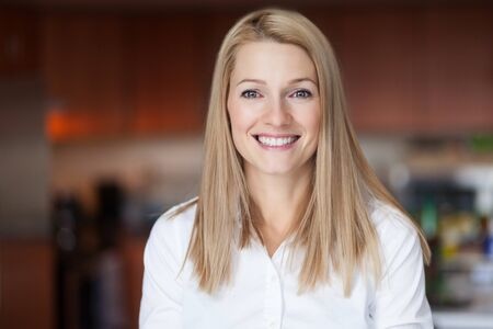 Close up Of A Smiling Caucasien blond woman in the kitchen at the office