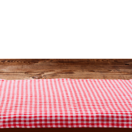 Empty wooden deck table with tablecloth on white for product montage