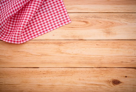Photo for Pure notebook for recording menu, recipe on red checkered tablecloth tartan. Wooden table close up view from top - Royalty Free Image