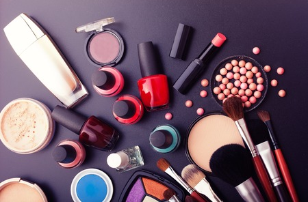 Various makeup products on dark background with copyspaceの写真素材