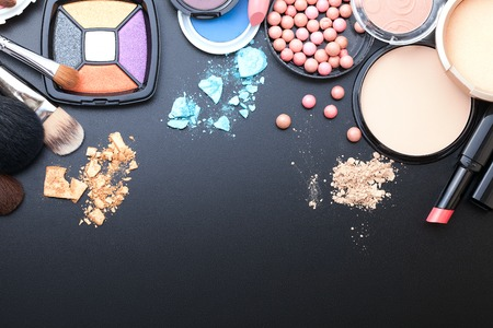 Photo pour Makeup cosmetics products on dark background with copy space. Cosmetics make up artist objects: lipstick, eye shadows, eyeliner, concealer, nail polish, powder, tools for make-up. Selective focus - image libre de droit