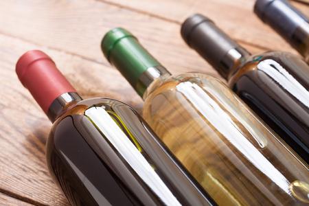 Wine bottles on wooden background. Flat mock up for design.