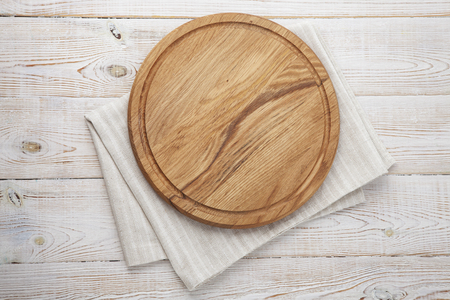 Foto de Pizza board, canvas napkin with lace on wooden table. Top view mock up - Imagen libre de derechos