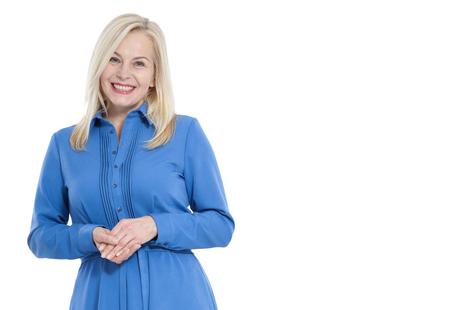 Foto de Friendly smiling middle aged woman in blue dress isolated - Imagen libre de derechos