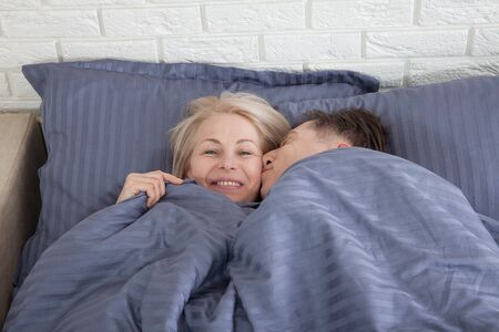 Photo for Mature couple together in bed. Pandemic isolation concept Selective focus. - Royalty Free Image