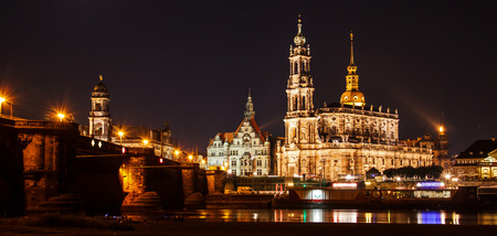 Night summer beautiful panoramic view of Cathedral of the Holy Trinity or Hofkirche, Bruehl's Terrace or the Balcony of Europe on Elbe river, Dresden, Saxony, Germany, Europe.