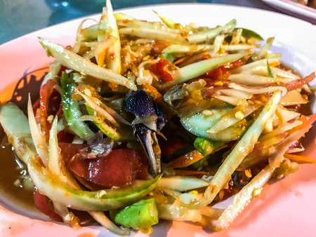On the street Thai green papaya salad, Som Tum, Bangkok, capital of street food, Thailand. Normally paired with sticky rice.