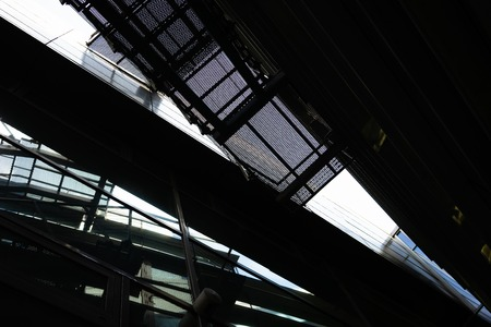 Photo for Fragments of the facade of a modern building of glass and metal with stairs and reflection - Royalty Free Image