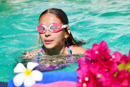 Photo pour The benefits of swimming in the pool. Spa treatments for children. Holidays in topics with children. - image libre de droit