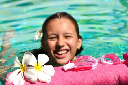 Photo pour Cute baby girl in the water. Relaxing water treatments. Vacation and travel concept at sea. Pool at the hotel. - image libre de droit
