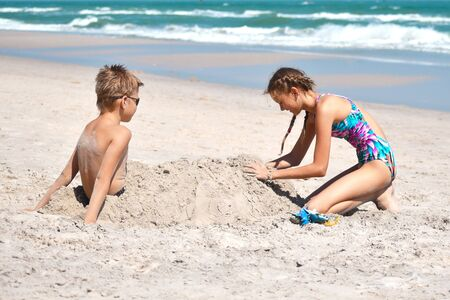 Photo for Happy children play together on the beach. - Royalty Free Image