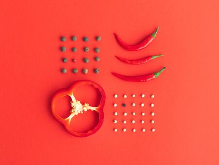 Photo for Knolling of different types of pepper: bell, chili, peppercorns against a red background. Flat lay style. - Royalty Free Image