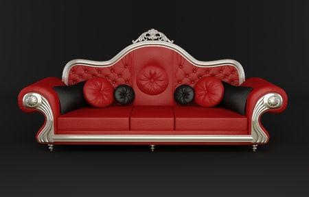 Red leather sofa with cushions