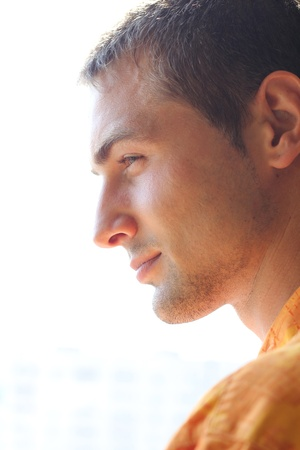 profile of handsome man outdoors