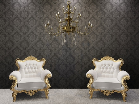 Golden chandelier with luxurious armchairs on black ornament background.