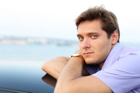 Young business man posing , outside shot