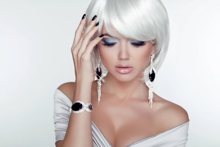 Fashion Beauty Girl. Woman Portrait with White Short Hair. Jewelry. Haircut and Makeup. Hairstyle. Make up. Vogue Style. Sexy Glamour Girl