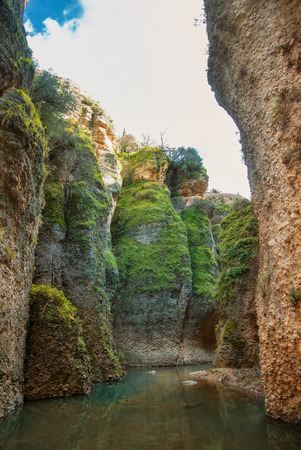 A view to Guadalevin river at El Tajo Gorge Canyon from the bottom of the secret water mine in Ronda, one of the most famous white villages (pueblos blancos) in Malaga province, Andalusia, Spain.