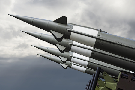 Nuclear Missiles With Warhead Aimed at Gloomy Sky. Balistic Rockets War Backgound.