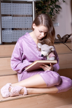 The girl in purple pajamas in the room